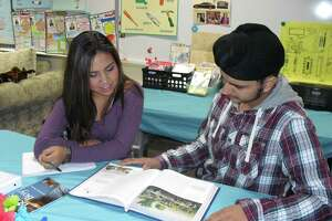 Valentina Linares and Karmanjot Singh read a chapter on American history during an English as a Second Language class in the Cy-Fair school district.