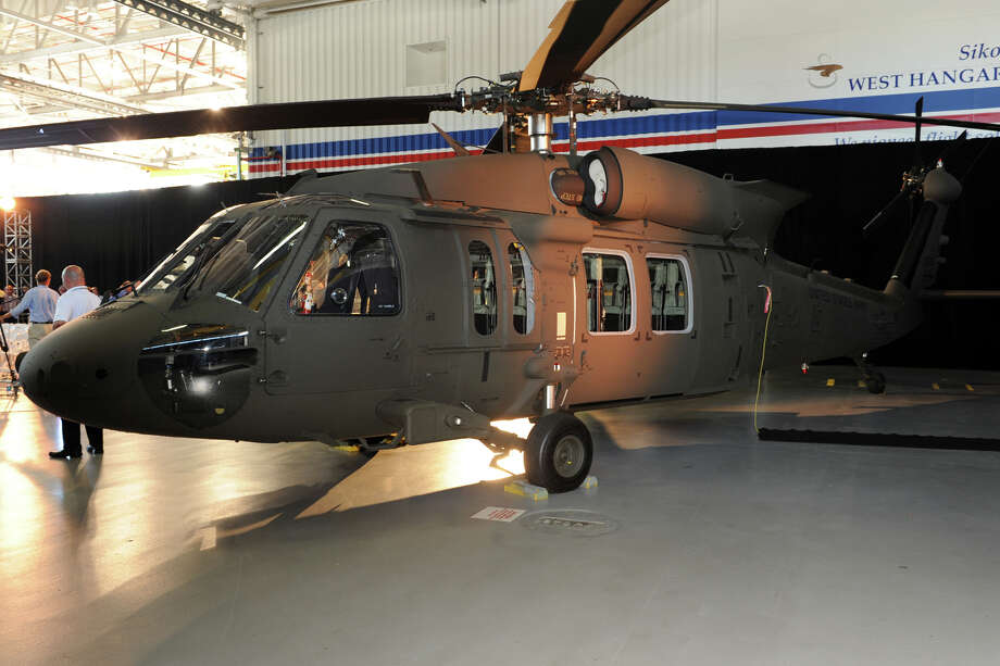 A H-60M Black Hawk helicopter on display during a ceremony at Sikorsky Aircraft, in Stratford, Conn. July 18th, 2012. The ceremony marked the delivery of the 500th H-60M Black Hawk to the Army. Photo: Ned Gerard / Connecticut Post