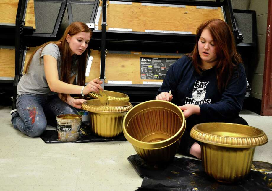 New Canaan High School Theatre members Rachel Guth, left, and Avery Wrenn paint vases that will be used at their upcoming show Thoroughly Modern Millie on Saturday, Jan. 18. The girls and more than 50 other students meet after school hours and on Saturdays to build and design their own props and costumes. Photo: Nelson Oliveira / New Canaan News