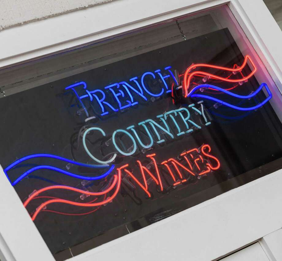 Tim Smith and Phyllis Adatto, co-owners of French Country Wines at 2433 Bartlett Street. Sign over front door. 12/30/13 (Craig H. Hartley/For the Chronicle) Photo: Craig Hartley, Freelance / Copyright: Craig H. Hartley