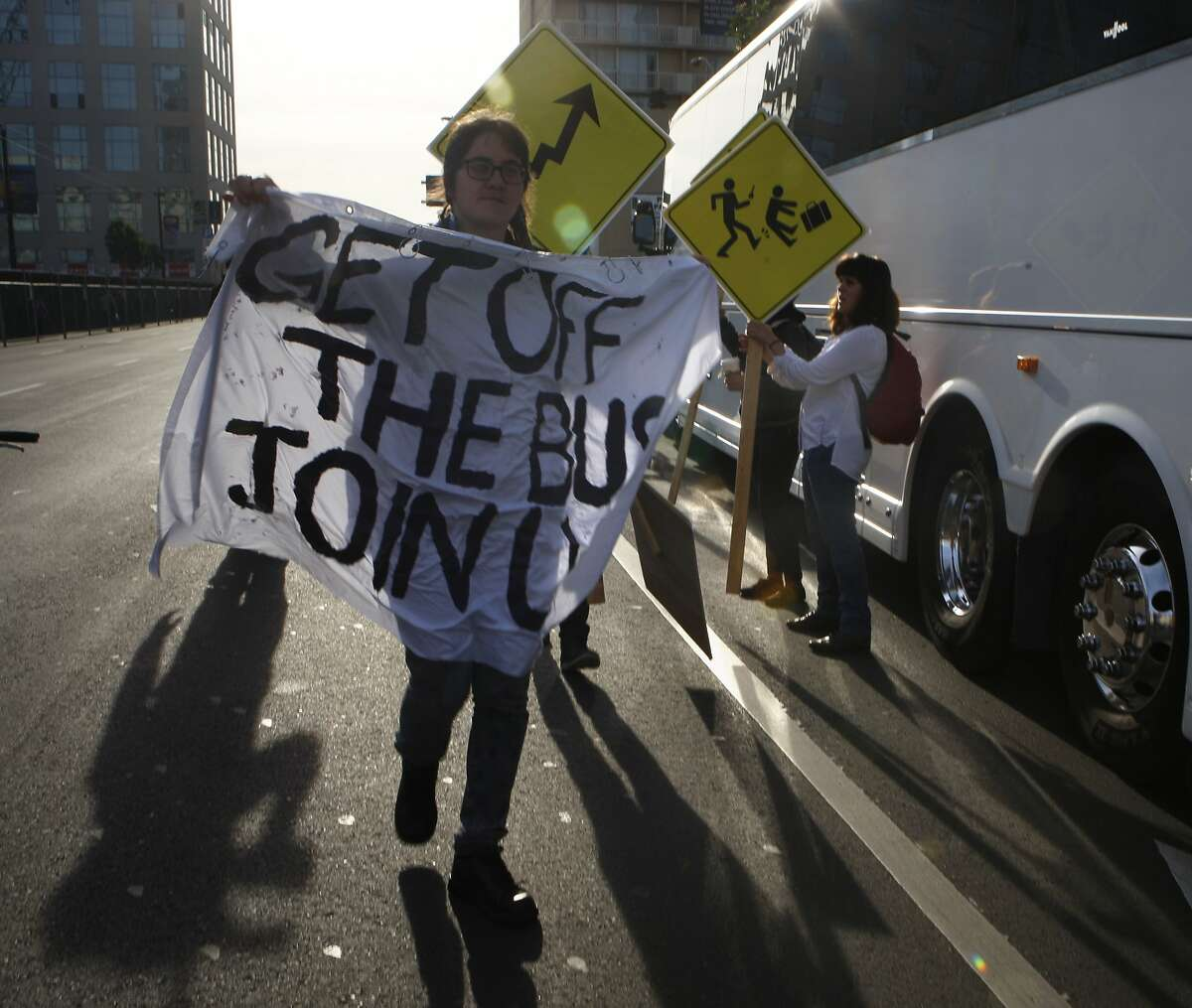 Protestors block a Facebook bus heading to Menlo Park on 8th at Market streets in San Francisco, Calif., on Tuesday, January 22, 2014. The San Francisco Metropolitan Transportation Agency votes on an 18-month pilot plan allowing Google buses to use designated Muni bus stops to pick up and drop off tech commuters to Silicon Valley.