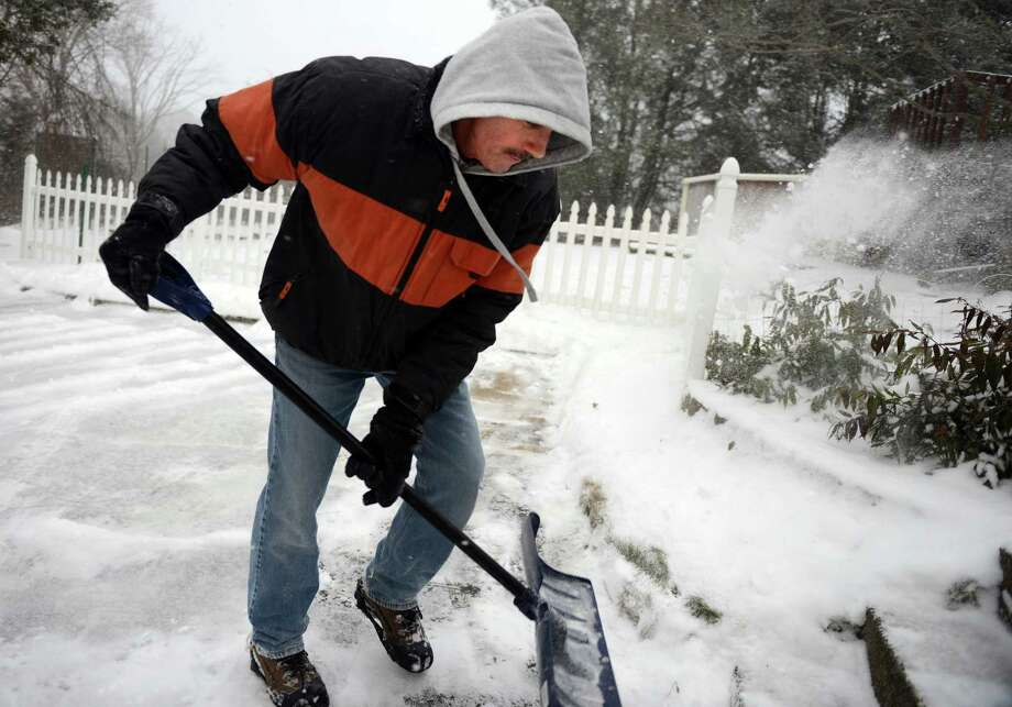 Michael Mairano gets a head start on shoveling his driveway Tuesday, Jan. 21, 2014 in Ansonia, Conn. Photo: Autumn Driscoll / Connecticut Post