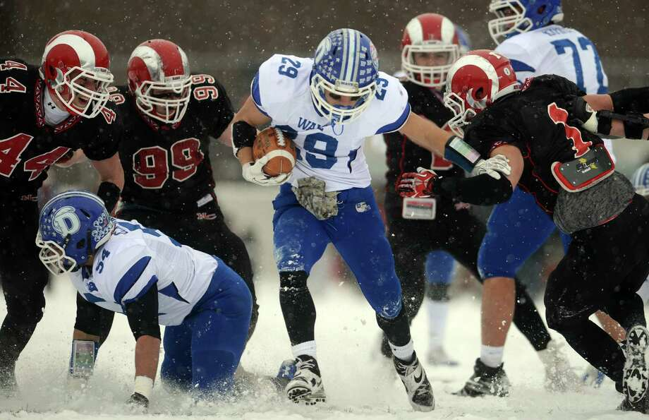 Darien's Myles Ridder carries the ball during the Class L state championship game against New Canaan on Saturday, Dec. 14, 2013 at Boyle Stadium in Stamford, Conn. Photo: Autumn Driscoll / Connecticut Post