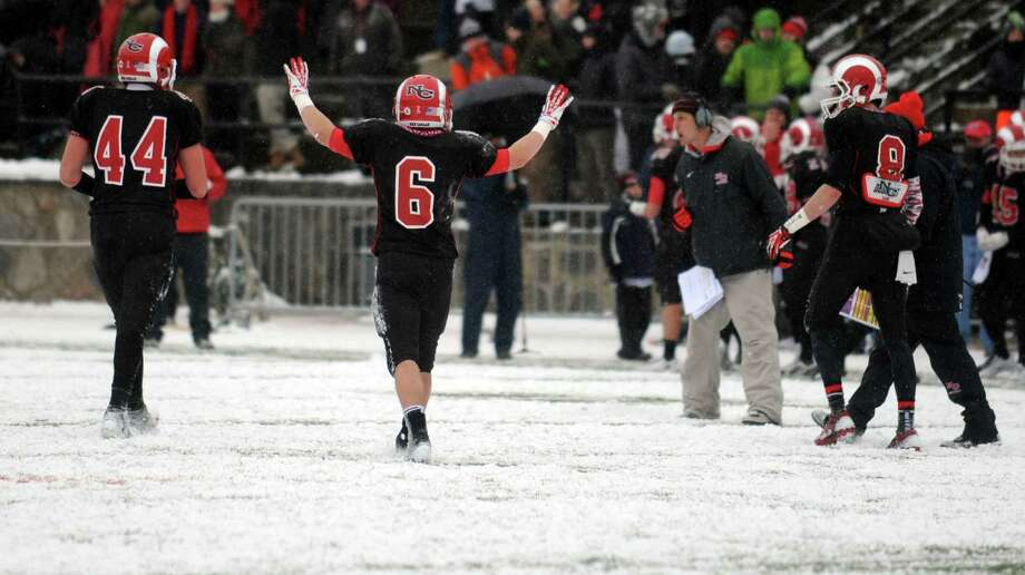 Scenes from the Class L state championship football game between New Canaan and Darien on Saturday, Dec. 14, 2013 at Boyle Stadium in Stamford, Conn. Photo: Autumn Driscoll / Connecticut Post