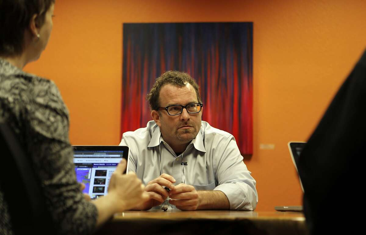Chris Butler with colleagues at his place of work, on Tuesday Jan. 21, 2014., where he is Chief Operating Officer of Tumlis, a real estate for sale start up company in San Francisco, Calif.Chris Butler was evicted from his Union Street apartment where he had lived for the past ten years and now his landlord is now renting it out on AirBnB.