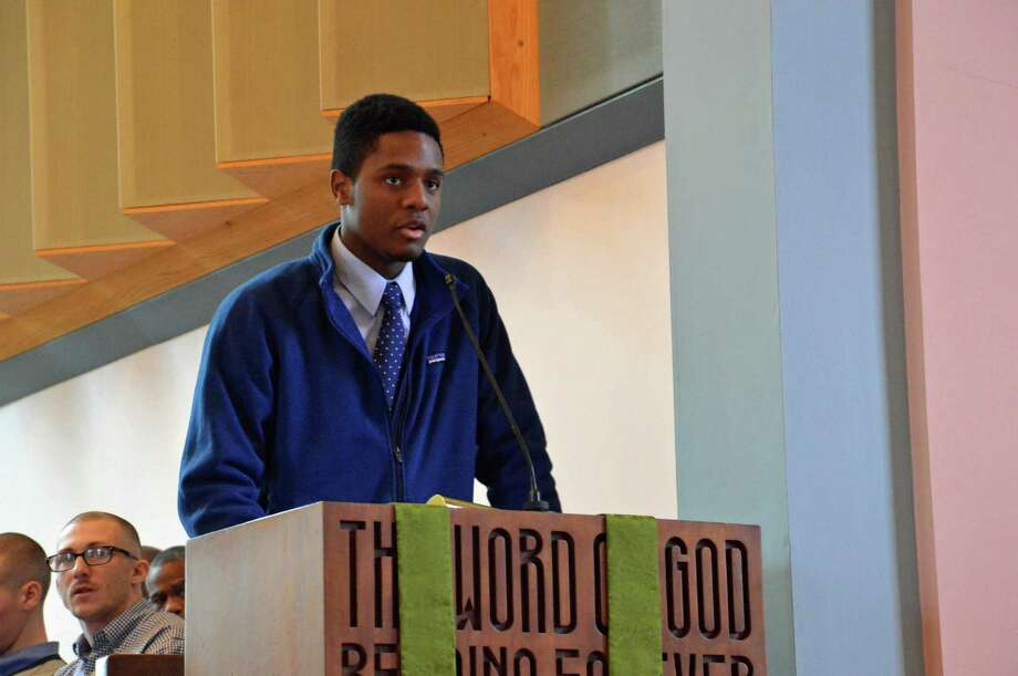 Christopher Andrews, who will graduate from New Canaan High School this spring, shares about the Rev. Dr. Martin Luther King's influence on him at Interfaith of New Canaanís annual service to honor King Monday, Jan. 20, at the United Methodist Church in New Canaan. Jarret Liotta / For the New Canaan News Photo: Contributed Photo, Contributed / New Canaan News Contributed