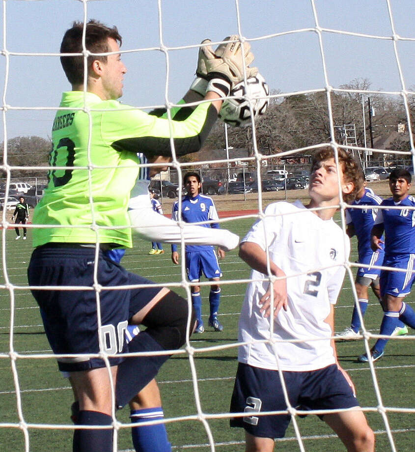 Boerne Champion goalkeeper Grayson Vansickle, left, records one of his six saves during the Chargers' match with Pharr Valley View as teammate Jake Struck (2) looks on. Photo: Mike Reeder / For The Northwest Weekly