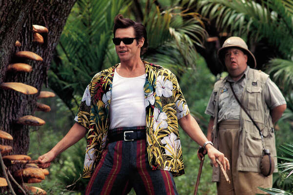 Jim Carrey ventures through the jungle in a scene from the film 'Ace Ventura: When Nature Calls', 1995.