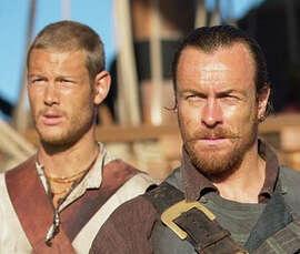 """Billy Bones (Tom Hopper), Captain Flint (Toby Stephens), Gates (Mark Ryan), John Silver (Luke Arnold) in, """"Black Sails."""""""