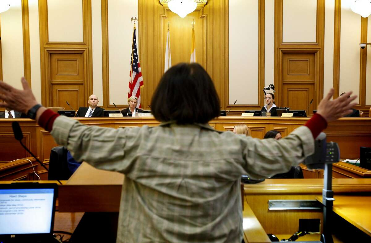 Kazmi Torii of San Francisco argues the buses should at least have to pay what she would have to pay in a ticket for stopping at a bus stop during discussion of a pilot program for shuttle bus fees and restrictions at an SFMTA board meeting in San Francisco, Calif., on Tuesday, January 21, 2014.