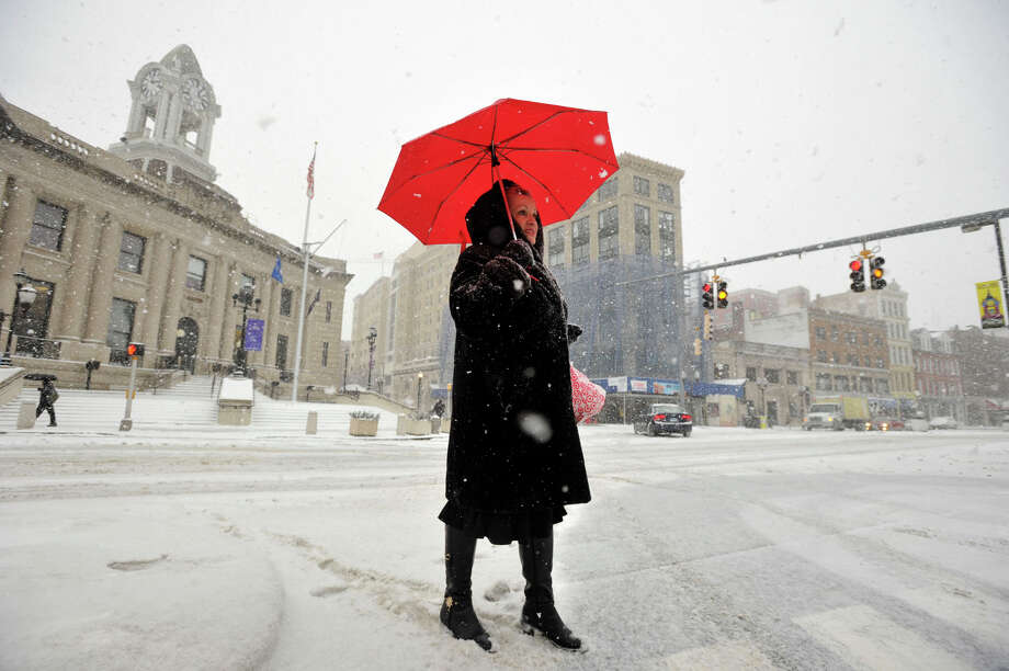 Victoria Burshtein waits for traffic to clear the intersection of Atlantic Street and Edith Sherman Drive while walking to Macy's in downtown Stamford, Conn., on Tuesday, Jan. 21, 2014. Photo: Jason Rearick / Stamford Advocate