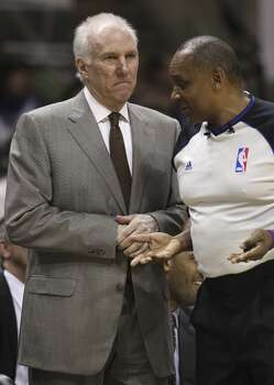 Spurs coach Gregg Popovich (left) and game official Eddie Rush discuss a call during the game against the Brooklyn Nets in the first half at the AT&T Center on Tuesday, Dec. 31, 2013. Photo: Kin Man Hui, San Antonio Express-News