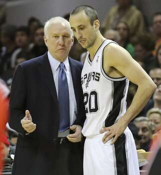 San Antonio Spurs' head coach Gregg Popovich talks with San Antonio Spurs' Manu Ginobili during second half action against the Toronto Raptors Monday Dec. 23, 2013 at the AT&T Center. The Spurs won 112-99. Photo: Edward A. Ornelas, San Antonio Express-News