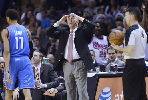 San Antonio Spurs coach Gregg Popovich reacts to a call that went against his team during second-half NBA action against the Oklahoma City Thunder at the AT&T Center on Saturday, Dec. 21, 2013. Oklahoma City won the game, 113-100. Photo: Billy Calzada, San Antonio Express-News