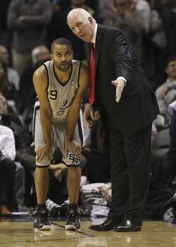 Spurs coach Gregg Popovich talks with Tony Parker (09) during break in the action against the Minnesota Timberwolves in the second half at the AT&T Center on Friday, Dec. 13, 2013. Spurs defeated the T'Wolves, 117-110. Photo: Kin Man Hui, San Antonio Express-News