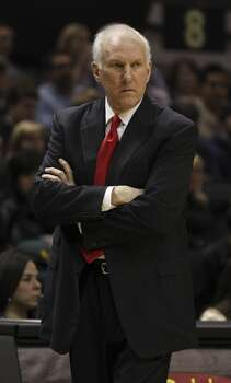 Spurs coach Gregg Popovich strolls the sideline during the game against the Minnesota Timberwolves in the first half at the AT&T Center on Friday, Dec. 13, 2013. Photo: Kin Man Hui, San Antonio Express-News