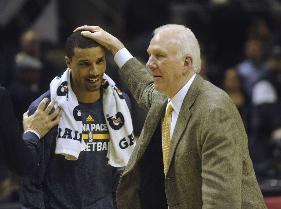 San Antonio Spurs coach Gregg Popovich greets Indiana Pacers guard George Hill, who used to play for the Spurs, after the Pacers beat the Spurs 111-100 in the AT&T Center on Saturday, Dec. 7, 2013. Photo: Billy Calzada, San Antonio Express-News