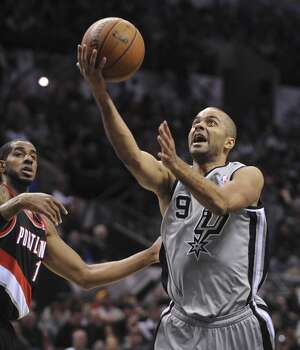Tony Parker (9) of the San Antonio Spurs lays up the b all against Portland during NBA action in the AT&T Center on Friday, Jan. 17, 2014. Photo: Billy Calzada, San Antonio Express-News