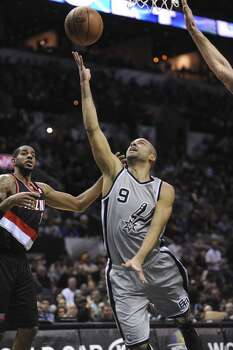 Tony Parker (9) of the San Antonio Spurs lays up the ball during NBA action against the Portland Trailblazers in the AT&T Center on Friday, Jan. 17, 2014. Photo: Billy Calzada, San Antonio Express-News
