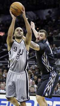 San Antonio Spurs' Tony Parker drives to the basket around Minnesota Timberwolves' Nikola Pekovic during second half action Sunday Jan. 12, 2014 at the AT&T Center. The Spurs won 104-86. Photo: Edward A. Ornelas, San Antonio Express-News