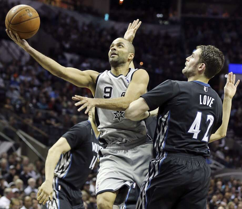 San Antonio Spurs' Tony Parker shoots around Minnesota Timberwolves' Kevin Love during first half action Sunday Jan. 12, 2014 at the AT&T Center. Photo: Edward A. Ornelas, San Antonio Express-News
