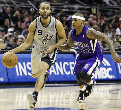 San Antonio Spurs' Tony Parker drives around Sacramento Kings' Isaiah Thomas during first half action Sunday Dec. 29, 2013 at the AT&T Center. Photo: Edward A. Ornelas, San Antonio Express-News