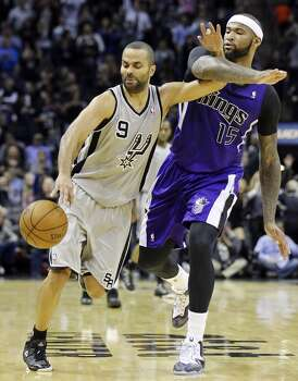 San Antonio Spurs' Tony Parker is fouled by Sacramento Kings' DeMarcus Cousins late in second half action Sunday Dec. 29, 2013 at the AT&T Center. The Spurs won 112-104. Photo: Edward A. Ornelas, San Antonio Express-News