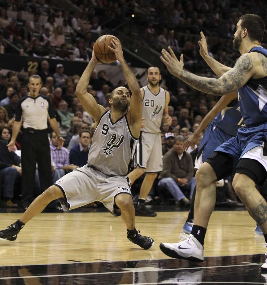 Spurs' Tony Parker (09) puts the moves on Minnesota Timberwolves' Nikola Pekovic (14) in the second half at the AT&T Center on Friday, Dec. 13, 2013. Spurs defeated the T'Wolves, 117-110. Photo: Kin Man Hui, San Antonio Express-News