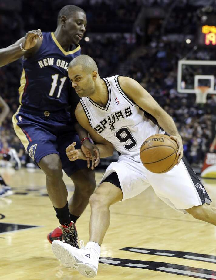 San Antonio Spurs' Tony Parker looks for room around New Orleans Pelicans' Jrue Holiday during second half action Monday Nov. 25, 2013 at the AT&T Center. The Spurs won 112-93. Photo: Edward A. Ornelas, San Antonio Express-News