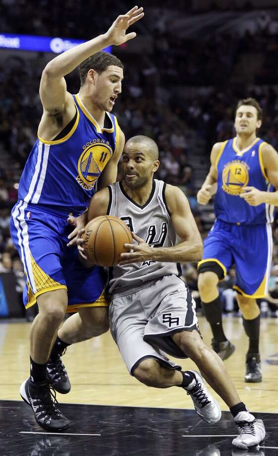 San Antonio Spurs' Tony Parker drives around Golden State Warriors' Klay Thompson during first half action Friday Nov. 8, 2013 at the AT&T Center. Photo: Edward A. Ornelas, San Antonio Express-News