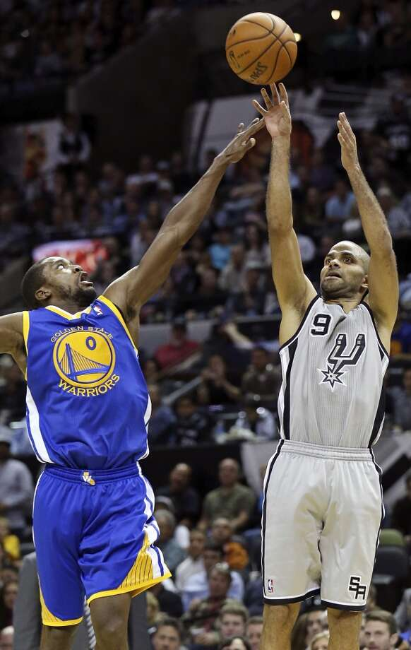 San Antonio Spurs' Tony Parker shoots over Golden State Warriors' Toney Douglas during second half action Friday Nov. 8, 2013 at the AT&T Center. The Spurs won 76-74. Photo: Edward A. Ornelas, San Antonio Express-News