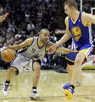 San Antonio Spurs' Tony Parker looks for room around Golden State Warriors' David Lee during second half action Friday Nov. 8, 2013 at the AT&T Center. The Spurs won 76-74. Photo: Edward A. Ornelas, San Antonio Express-News