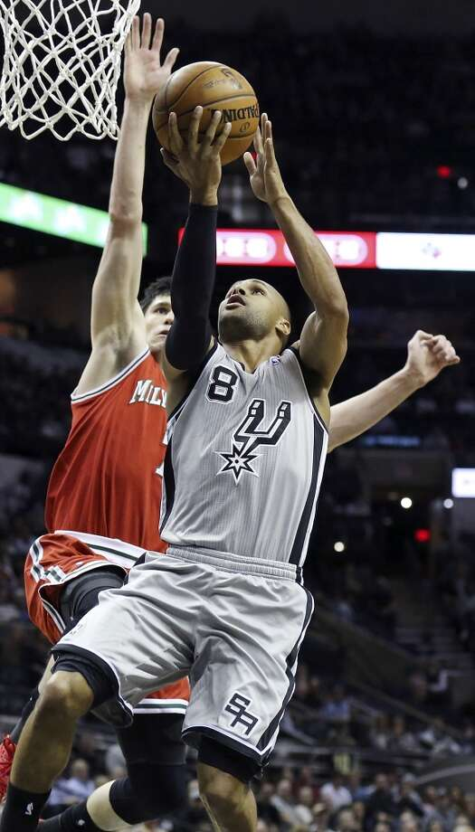 San Antonio Spurs' Patty Mills shoots around Milwaukee Bucks' Ersan Ilyasova during first half action Sunday Jan. 19, 2014 at the AT&T Center. Photo: Edward A. Ornelas, San Antonio Express-News