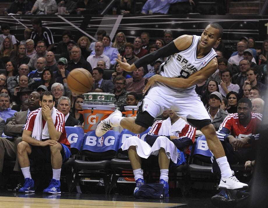 Patty Mills of the San Antonio Spurs saves the ball from going out of bounds during second-half NBA action against the Dallas Mavericks at the AT&T Center on Wednesday, Jan. 8, 2014. The Spurs won the game, 112-90. Photo: Billy Calzada, San Antonio Express-News