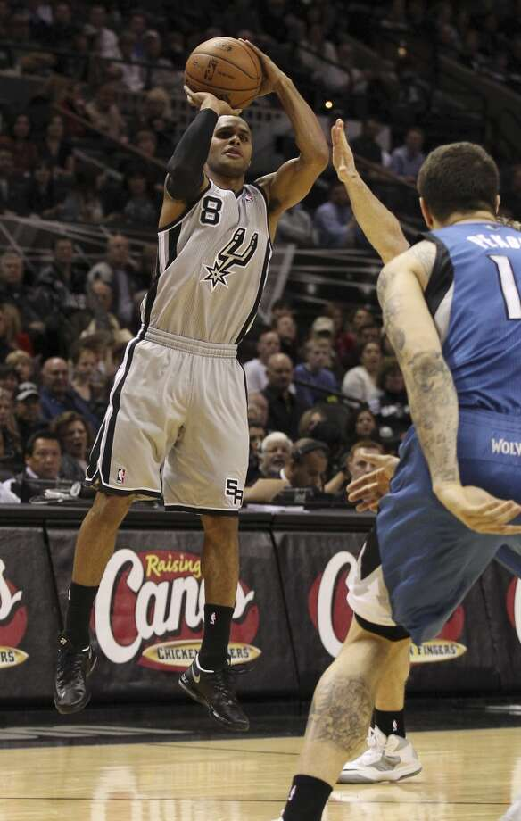 Spurs' Patty Mills (08) takes a three-point shot attempt against the Minnesota Timberwolves in the first half at the AT&T Center on Friday, Dec. 13, 2013. Photo: Kin Man Hui, San Antonio Express-News