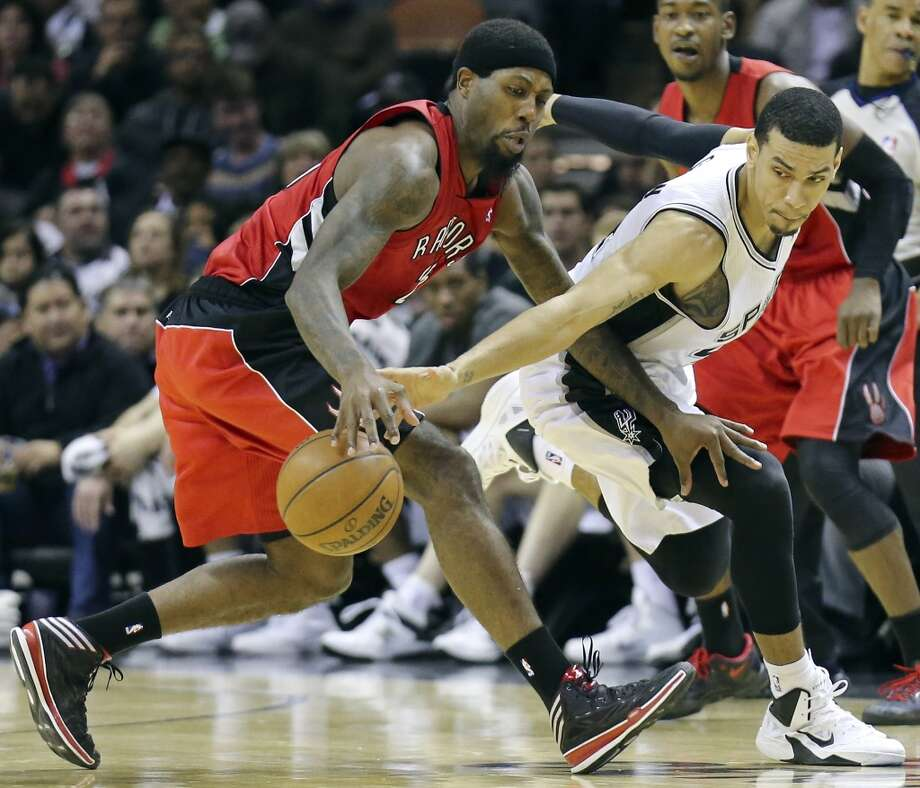 Toronto Raptors' John Salmons and San Antonio Spurs' Danny Green chase after a loose ball during second half action Monday Dec. 23, 2013 at the AT&T Center. The Spurs won 112-99. Photo: Edward A. Ornelas, San Antonio Express-News