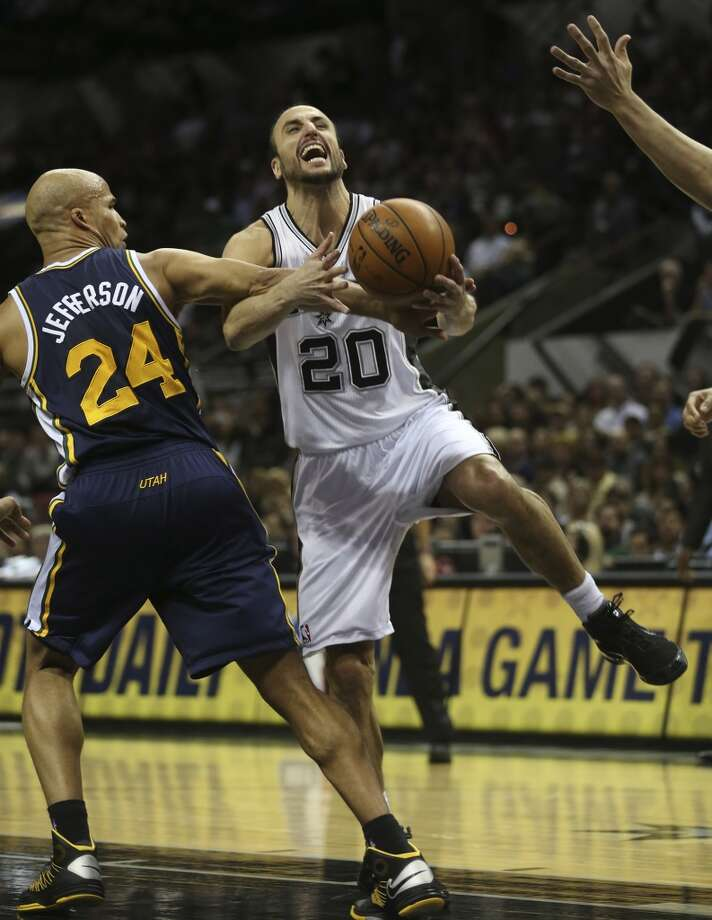 San Antonio Spurs' Manu Ginobili is fouled by Utah Jazz' Richard Jefferson during the first half at the AT&T Center, Wednesday, Jan. 15, 2014. Photo: Jerry Lara, San Antonio Express-News
