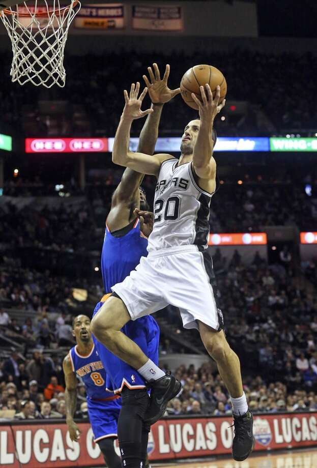 Manu Ginobili launches in for a layup in the first half as the Spurs host the New York Knicks at the AT&T Center on January 2, 2014. Photo: Tom Reel, San Antonio Express-News