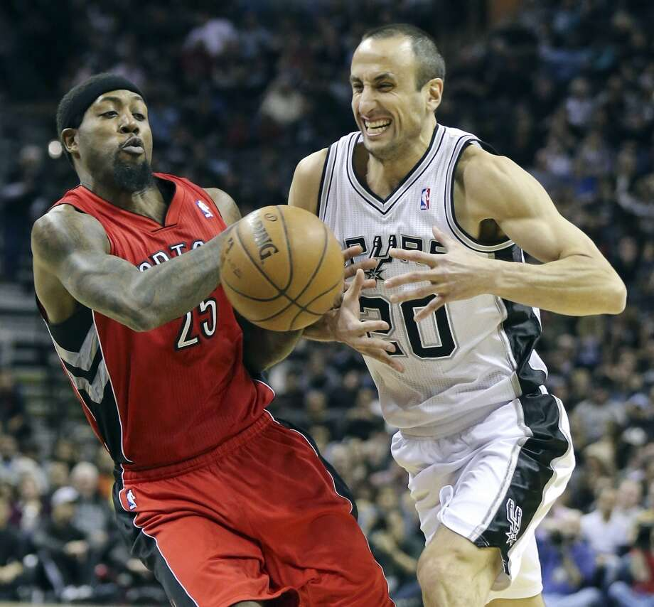 Toronto Raptors' John Salmons and San Antonio Spurs'  Manu Ginobili grab for a loose ball during first half action Monday Dec. 23, 2013 at the AT&T Center. Photo: Edward A. Ornelas, San Antonio Express-News