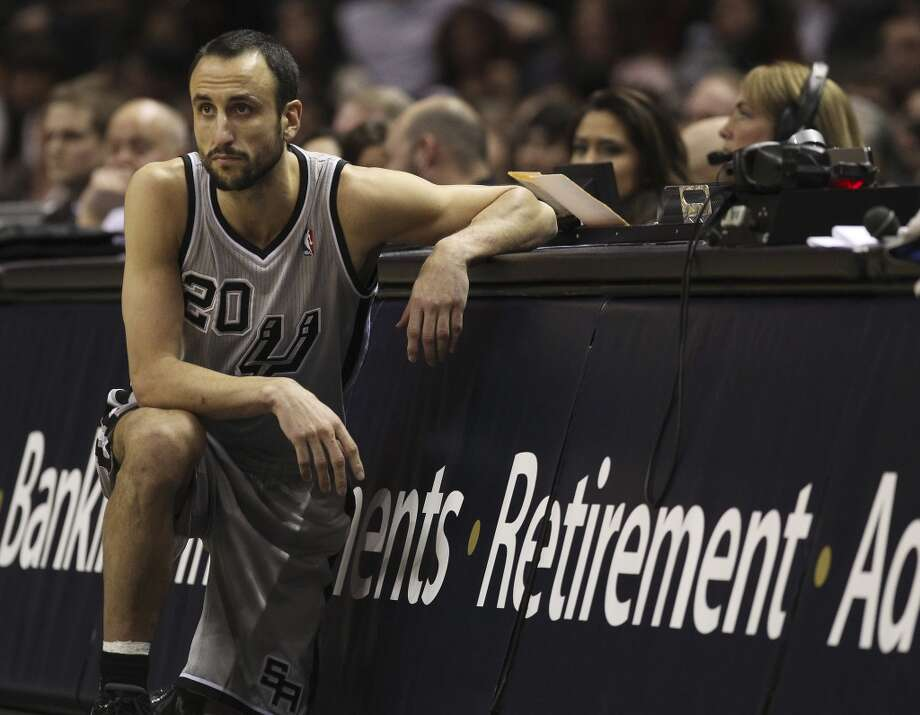 Spurs' Manu Ginobili (20) waits to check in the game against the Minnesota Timberwolves in the second half at the AT&T Center on Friday, Dec. 13, 2013. Spurs defeated the T'Wolves, 117-110. Photo: Kin Man Hui, San Antonio Express-News