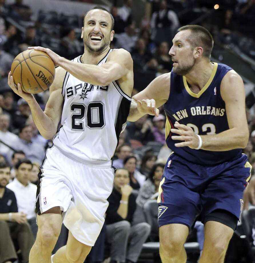 San Antonio Spurs' Manu Ginobili looks for room around New Orleans Pelicans' Ryan Anderson during first half action Monday Nov. 25, 2013 at the AT&T Center. Photo: Edward A. Ornelas, San Antonio Express-News