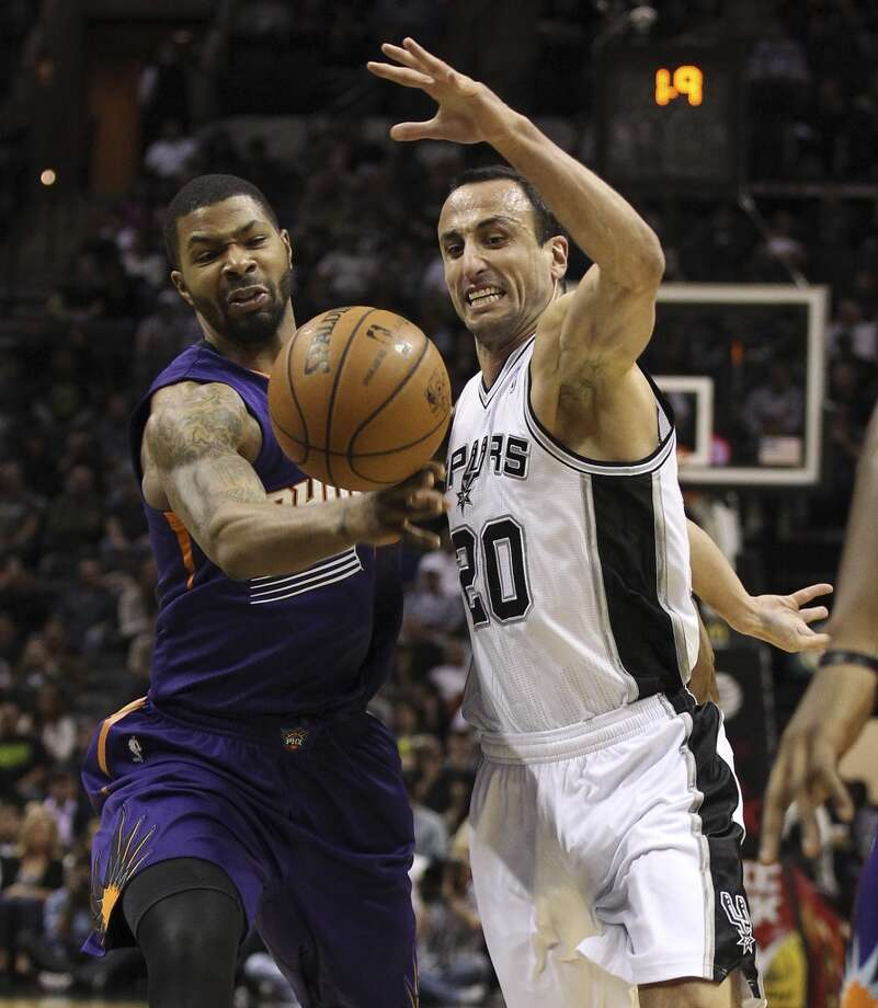 Spurs' Manu Ginobili (20) gets the ball knocked away by Phoenix Suns' Marcus Morris (15) at the AT&T Center on Wednesday, Nov. 6, 2013. Photo: Kin Man Hui, San Antonio Express-News