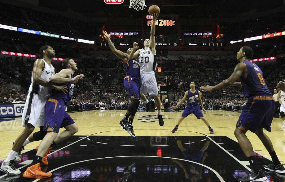Spurs' Manu Ginobili (20) goes up for a shot against Phoenix Suns' P.J. Tucker (17) at the AT&T Center on Wednesday, Nov. 6, 2013. Photo: Kin Man Hui, San Antonio Express-News