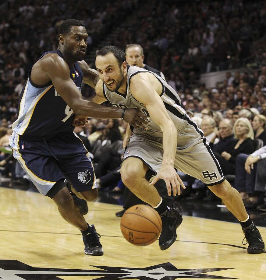 Spurs' Manu Ginobili (20) drives the basket against Memphis Grizzlies' Tony Allen (09) in the second half at the home opener at the AT&T Center on Wednesday, Oct. 30, 2013. Spurs defeated the Grizzlies, 101-94. Photo: Kin Man Hui, San Antonio Express-News