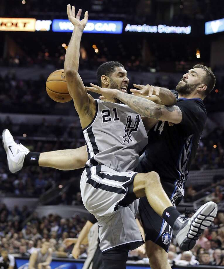 San Antonio Spurs' Tim Duncan is fouled by Minnesota Timberwolves' Nikola Pekovic during second half action Sunday Jan. 12, 2014 at the AT&T Center. The Spurs won 104-86. Photo: Edward A. Ornelas, San Antonio Express-News