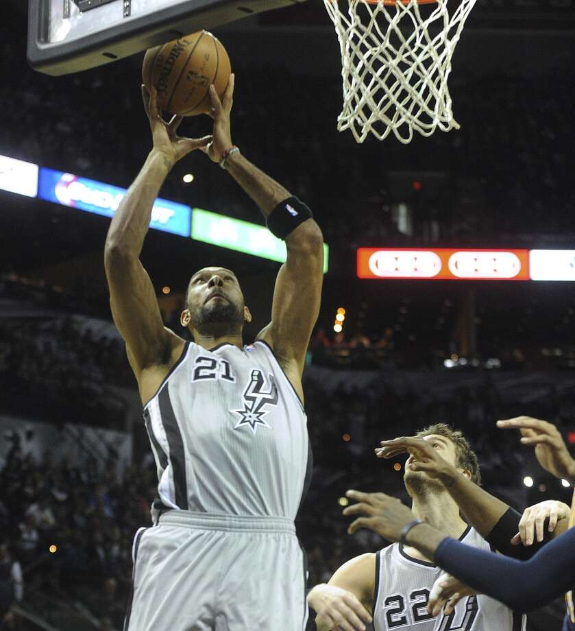 Tim Duncan of the San Antonio Spurs follows through on his own shot during NBA action against the Indiana Pacers in the AT&T Center on Saturday, Dec. 7, 2013. Photo: Billy Calzada, San Antonio Express-News