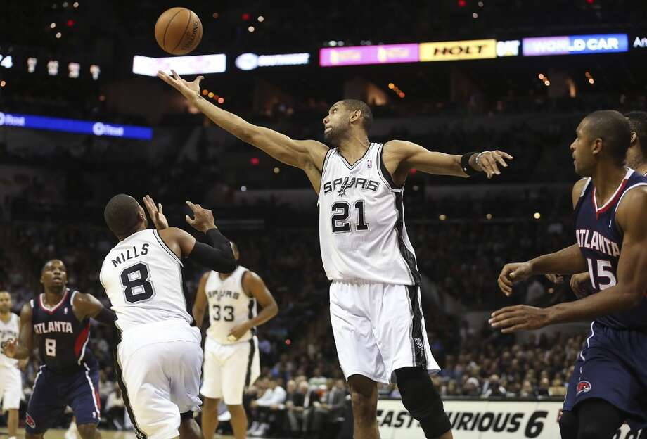 San Antonio Spurs' Tim Duncan reaches for a rebound during the second half against the Atlanta Hawks at the AT&T Center, Monday, Dec. 2, 2013. The Spurs won 102-100. Photo: Jerry Lara, San Antonio Express-News