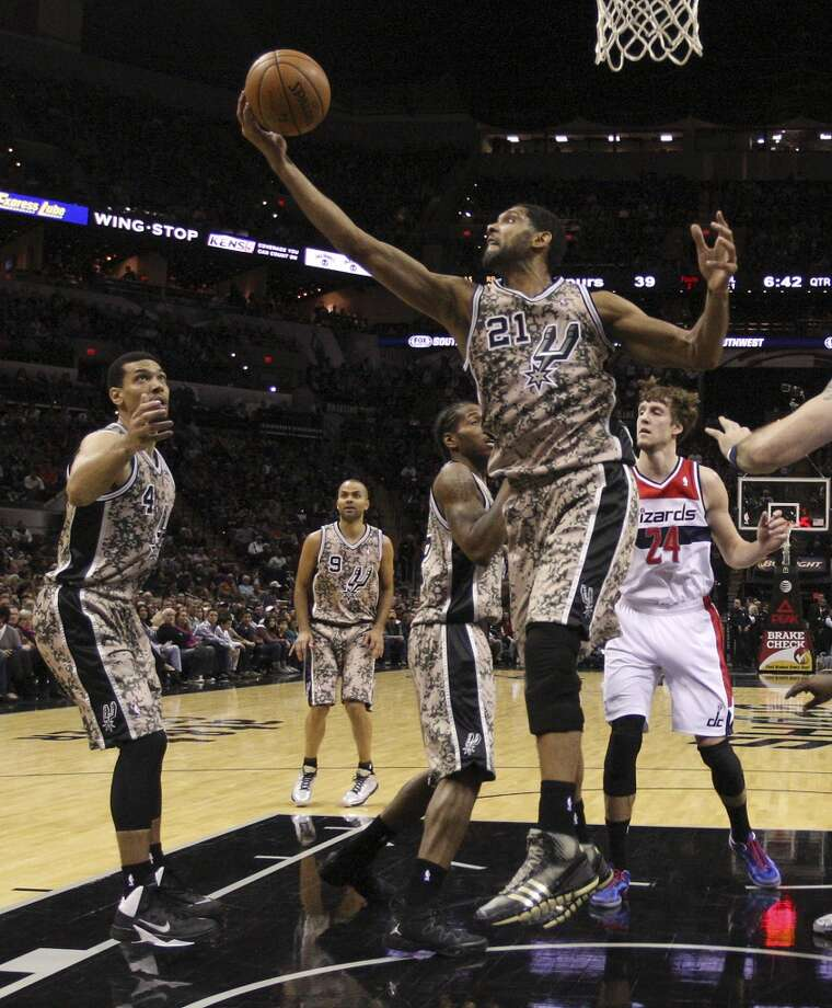 San Antonio Spurs' Tim Duncan goes for a rebound during the first half against the Washington Wizards at the AT&T Center, Wednesday, Nov. 13, 2013. The Spurs won 92-79. Photo: Jerry Lara, San Antonio Express-News
