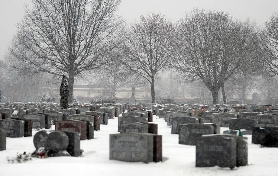 A view of St. Michael's Cemetary as a snowstorm hits the reagion in Stratford, Conn. on Tuesday January 21, 2014. Photo: Christian Abraham / Connecticut Post