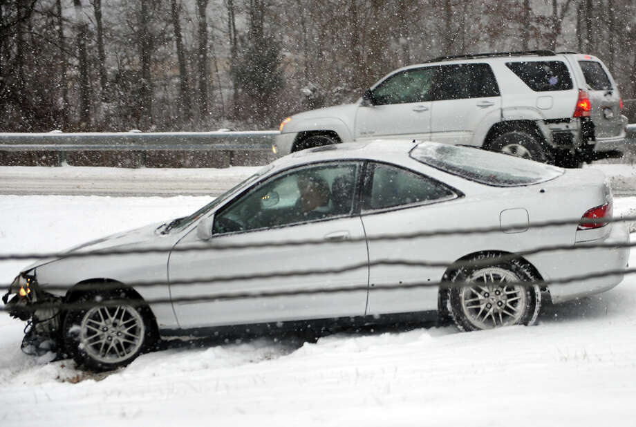 A motorist sits stranded after sliding off of Exit 34 on Interstate 95 southbound due to the snowstorm that is pounding the region in Milford, Conn. on Tuesday January 21, 2014. Photo: Christian Abraham / Connecticut Post